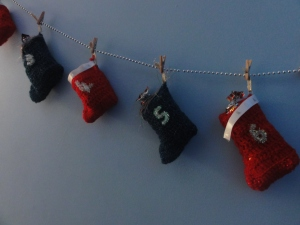 I crocheted these. The numbers are pipe cleaners stuck on with glue and the top has ribbon stuck on.
