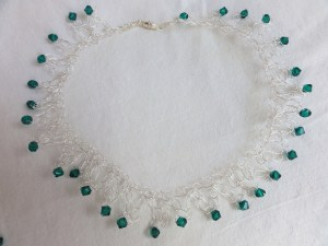 A delicate beaded and wire necklace.