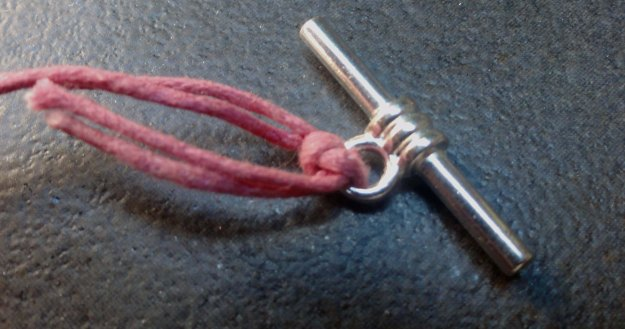 Attach on end of the finding with a knot.