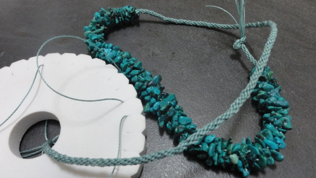 I did a bit more kumihimo to make a 'chain' for the turquoise chips I started on holiday. A step closer to being completed.