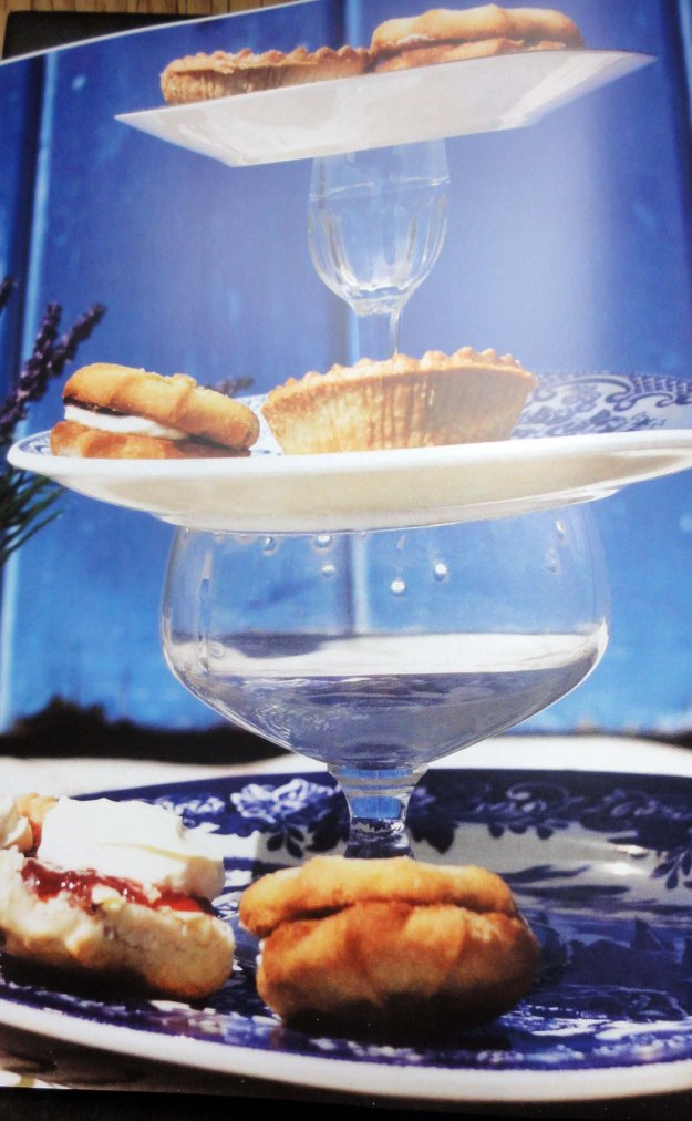 A cake stand made from plates and glasses.