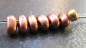 Thread on 6 twin beads and make a circle by going through them twice.
