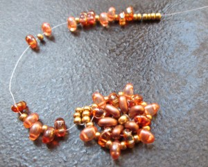Thread on 2 twin beads, 1 seed bead, 2 twin beads etc until the band will fit around your finger.