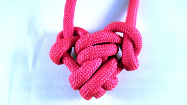 A knotted heart made from paracord.