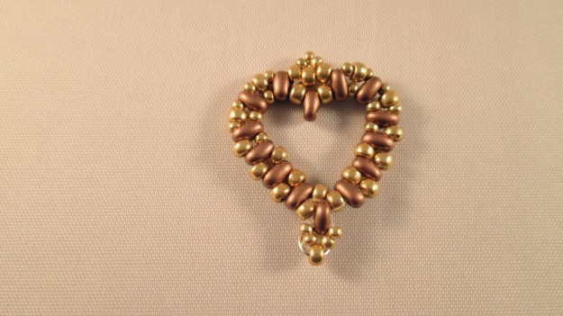 This beaded earring is designed to have some 'dangly bits' added to the bottom.
