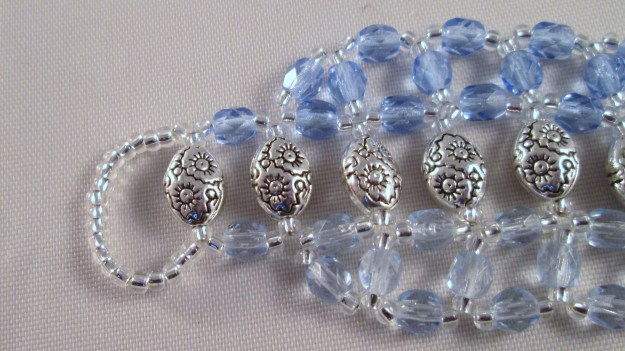 Seed beads form a loop for one end of the clasp.